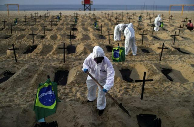 100 Graves Dug At Copacabana Beach To Protest Brazil's COVID-19 Response